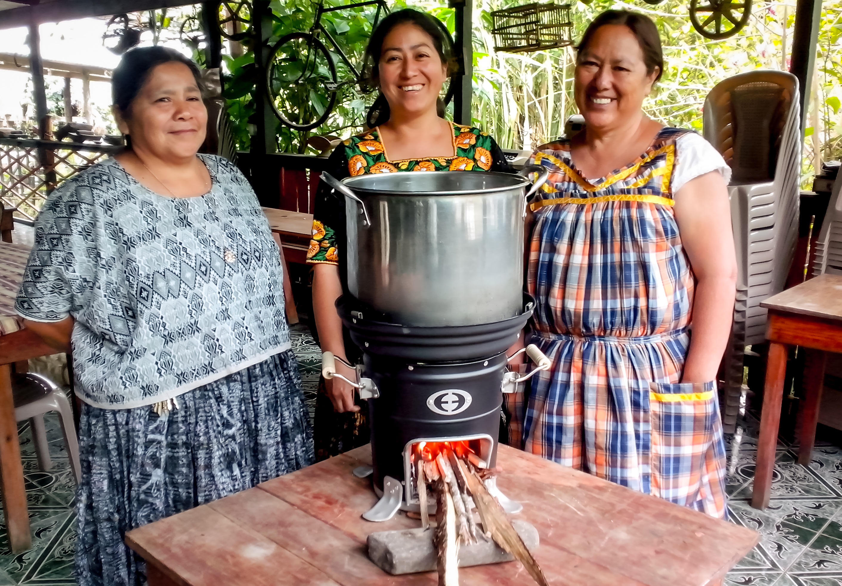 Calvert Foundation's Community Investment Notes funnel money to community development organizations like Envirofit, which provides affordable, energy-efficient, durable cookstoves to people in developing countries, like these women in Honduras. | Photo from Envirofit