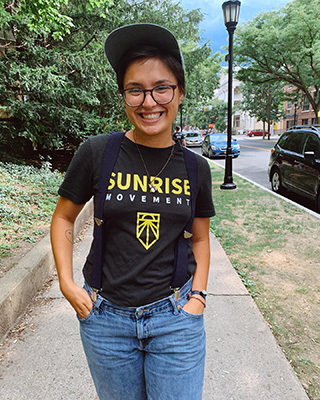 smiling person wearing Sunrise Movement t-shirt
