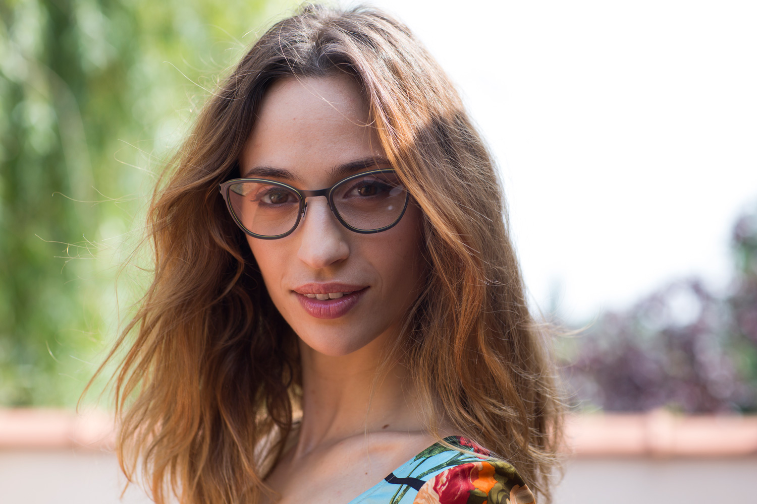 Model wearing SKA148 glasses from Nature Eyes made from recycled titanium and plant-based plastic.