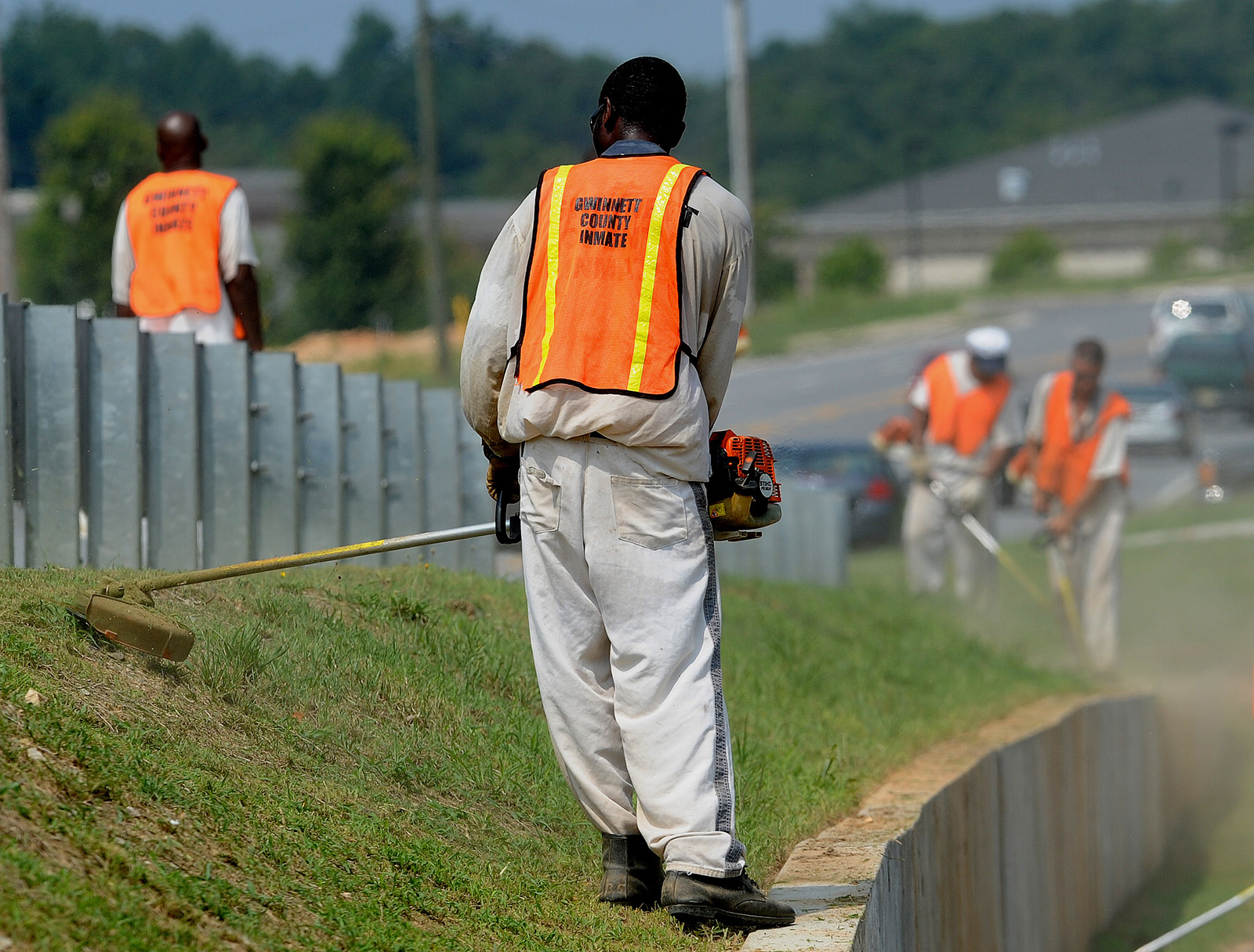 prison laborer working on the side of the road