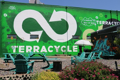 terracycle courtyard with infinity sign mural