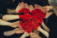 peoples hands together as a heart