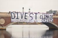 Boston-area university students gather for a joint banner drop over the Charles River to urge fossil fuel divestment.