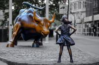 Fearless Girl facing Charging Bull Statue
