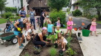 Parents and Children Planting a garden