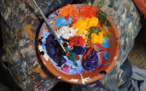 Paint on a palette with a paintbrush