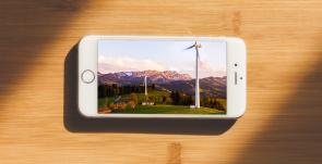 cell phone with image of wind turbines