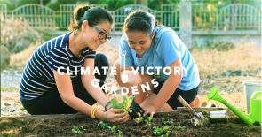 Two girls planting a Climate Victory Garden