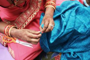 An artisan carefully handcrafts the Kantha Jewelry.