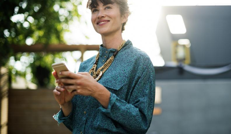 woman smiling with phone