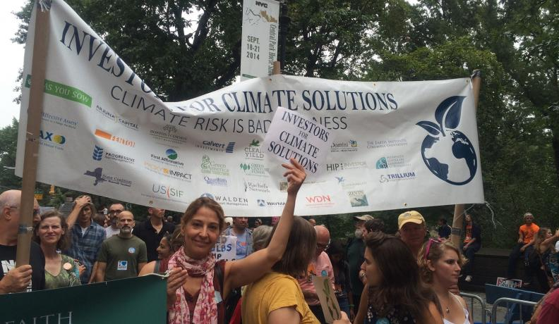 Shareholder activists from the Interfaith Center on Corporate Responsibility urge others to join them in addressing companies' lack of action on global warming at the People's Climate March in 2014.