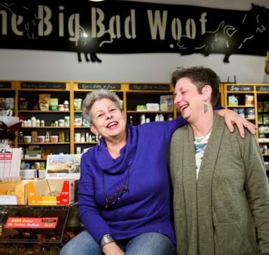 Julie Paez and Pennye Jones-Napier in their store, the Big Bad Woof, laughing