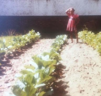 vintage photo of young girl in large urban garden