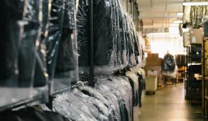 Image: suit rack at dry cleaners. Non-toxic dry cleaning.