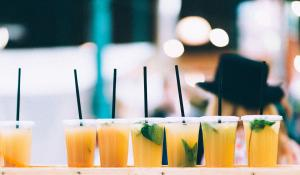 Row of drinks with plastic straws