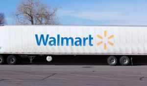 Denver, U.S.A. - February 17, 2013: Walmart semi in a parking lot. Blue and yellow Walmart logo are on the side of a white semi trailer.