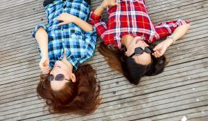 Two women with plaid shirts via Pexel