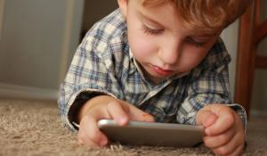 kid playing on a cell phone