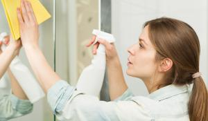 woman spraying cleaning product