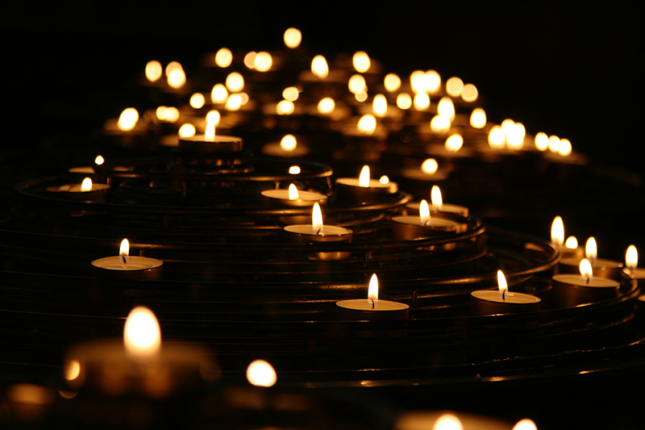 Lighted candles in the dark