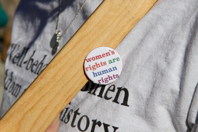 "Pin with the words ""women's rights are human rights"""
