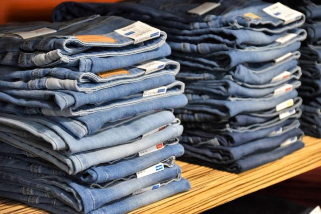 two stacks of light wash blue jeans
