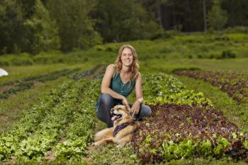 Photo of author with her dog on the farm.