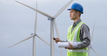 Image of a worker on a wind farm